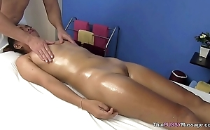 Transitory Asian girl receives oil massage